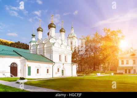 The Chernigov Martyrs church in Moscow, Russia with sun rays - Stock Photo