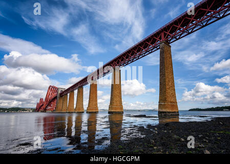 The Forth Bridge is a cantilever railway bridge over the Firth of Forth in the east of Scotland, - Stock Photo