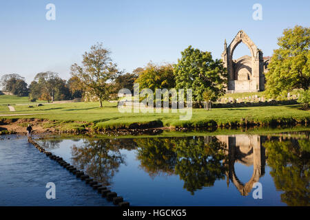 River Wharfe reflecting Bolton Abbey Augustinian Priory ruins in Yorkshire Dales National Park. Bolton Abbey Wharfedale - Stock Photo