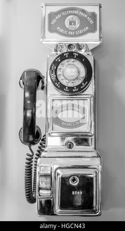 Vintage, old-style, retro, coin operated, pay telephone, call from the past. - Stock Photo