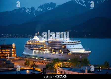 View of the pier and downtown of Juneau, Alaska. Downtown Juneau sits snugly between Mount Juneau, Mount Roberts - Stock Photo