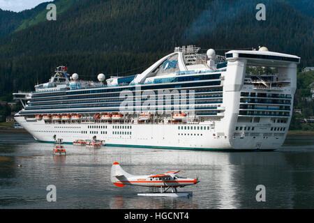 Star Princess docked at the South Franklin dock, Juneau, Alaska. Sightseeing seaplanes parked at the water front - Stock Photo