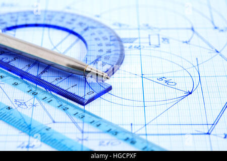 Business concept. Closeup of pen near rulers on graph paper with draft - Stock Photo