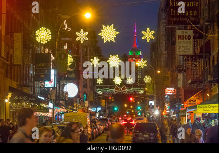 Empire State Building with Christmas lights seen from Mulberry Street in Little Italy - Stock Photo