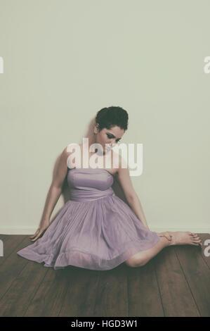 Sad woman sat on the floor