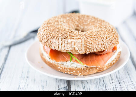 Fresh made Bagel with Salmon (selective focus; detailed close-up shot) - Stock Photo