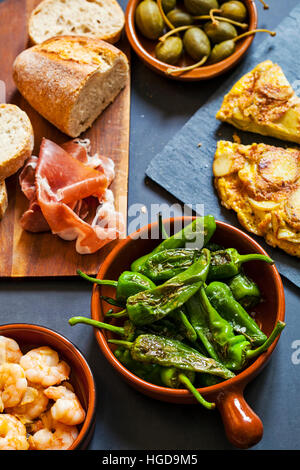 Authentic Spanish tapas with padron peppers,  garlic prawns and traditional tortilla - Stock Photo