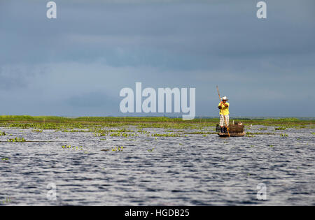 Thailand, Patthalung, Tale Noi, Fisherman, on boat with fish traps - Stock Photo