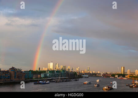 England, London, Rainbow over The Thames River and Docklands - Stock Photo