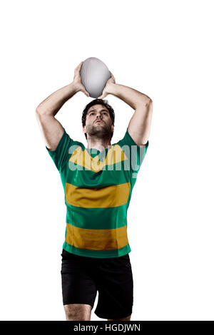 Rugby player in a green and gold uniform. White Background - Stock Photo