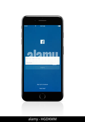 Apple iPhone 7 Plus, with Facebook login screen on its display - Stock Photo