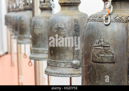 Closeup row of bells in buddhist temple in Thailand. Buddhist temple bells. Bells of the old temple in Thailand - Stock Photo