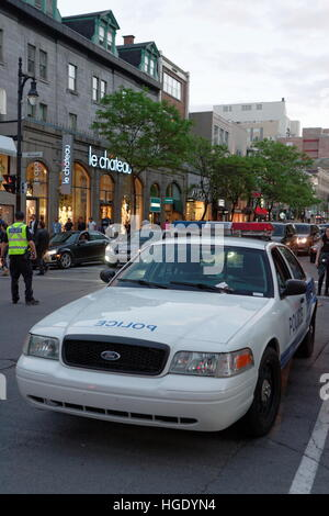 A police cruiser parked on Ste-Catherine street in the heart of downtown Montreal, Quebec - Stock Photo