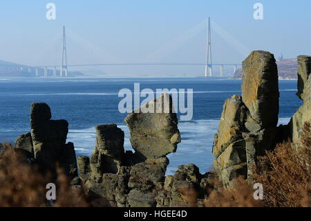 Vladivostok, Russia. 7th Jan, 2017. A view of a bridge over the Zolotoy Rog [Golden Horn] Bay from the lighthouse - Stock Photo