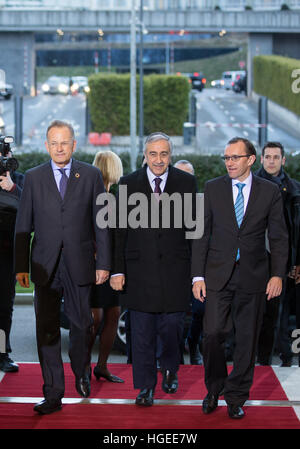 Geneva. 9th Jan, 2017. Turkish Cypriot leader Mustafa Akinci (C) arrives for the reunification negotiations in Geneva, - Stock Photo