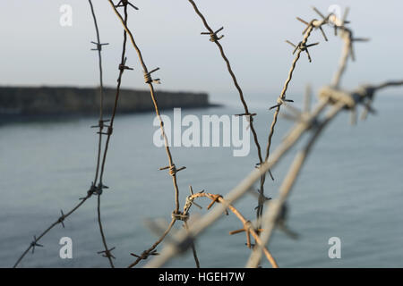 Barbed wire in Pointe du Hoc, Normandy, France - Stock Photo
