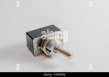A Studio Photograph of an Old Metal Toggle Switch - Stock Photo