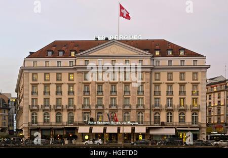 Four Seasons Hotel des Bergues on an evening in December, Geneva, Switzerland - Stock Photo