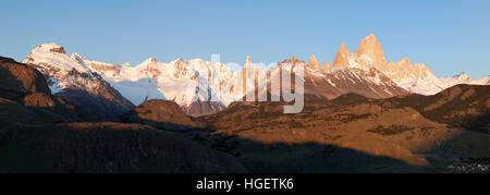 View over Mount Fitz Roy and Cerro Torre at sunrise from Mirador de los Condores, El Chalten, Patagonia, Argentina - Stock Photo