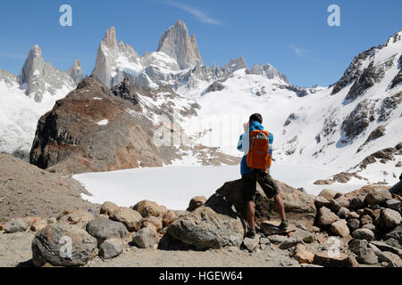 Hiker photographing Laguna de los Tres and Mount Fitz Roy, El Chalten, Patagonia, Argentina, South America - Stock Photo
