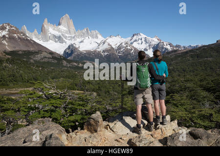 Hikers viewing Mount Fitz Roy on Laguna de Los Tres trail, El Chalten, Patagonia, Argentina, South America - Stock Photo
