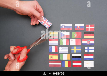 European flags and great britain flag on hands - Stock Photo