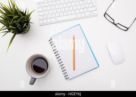 White minimal desk office with cup of coffee pencil glasses - Stock Photo