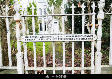 A fomer LNER  railway warning sign 'Any Person who Omits to Shut and Fasten This Gate is Liable to a Penalty not - Stock Photo
