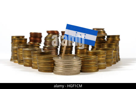 Honduras flag waving with stack of money coins - Stock Photo