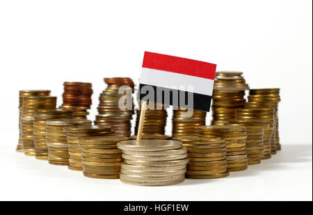 Yemen flag waving with stack of money coins - Stock Photo