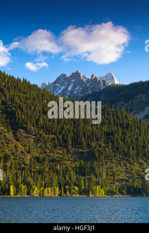 Twin Lakes, Bridgeport, CA. Mountain lake with Saw Tooth mountain range and blue sky and clouds. - Stock Photo