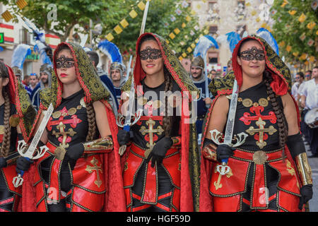 Women in historic clothing, Moors and Christians Parade, Moros y Cristianos, Jijona or Xixona, Province of Alicante - Stock Photo