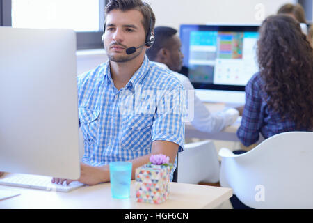 startup business, software developer working on desktop computer - Stock Photo