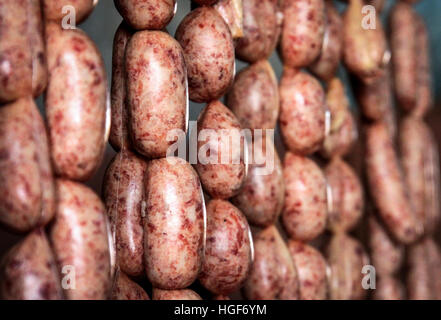 Sausages on sale in the african village market - Stock Photo