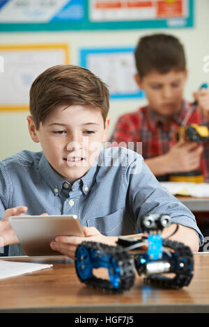 Pupils In Science Lesson Studying Robotics - Stock Photo