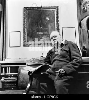 Winston Churchill in his office under a portrait of his wife Clementine. 1947 - Stock Photo