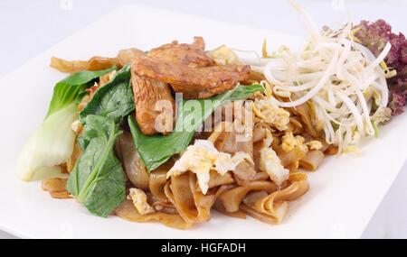 Stir fried flat rice noodle chicken Thai foods - Stock Photo