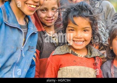 Dolpo, Nepal - circa May 2012: Small girl with brown hair and beautiful brown eyes wears earrings in Dolpo, Nepal. - Stock Photo