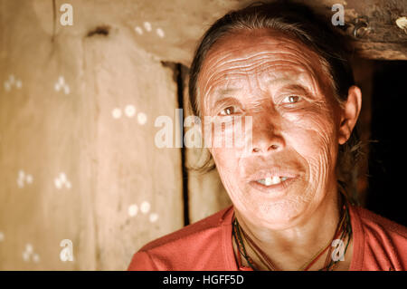 Dolpo, Nepal - circa May 2012: Old native woman with wrinkles and bright brown eyes in her house in Dolpo, Nepal. - Stock Photo
