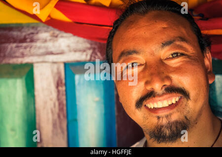 Dolpo, Nepal - circa May 2012: Native man with black moustache and beard with glittering eyes in Dolpo, Nepal. Documentary - Stock Photo
