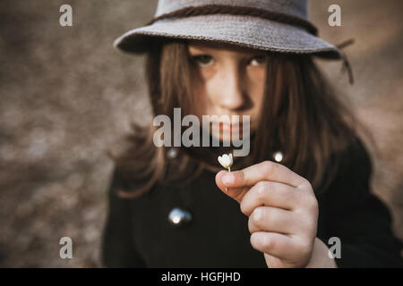 little girl in a black coat and hat - Stock Photo