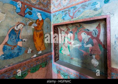 Wall paintings in Safavid grand palace Ali Qapu located at Naqsh e Jahan Square in Isfahan, capital of Isfahan Province - Stock Photo