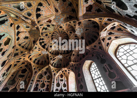 Ceiling of Music Hall in Safavid grand palace Ali Qapu located at Naqsh e Jahan Square in Isfahan, Iran - Stock Photo