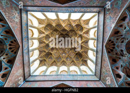 Ceiling of Music Hall in Safavid grand palace Ali Qapu located at Naqsh e Jahan Square in Isfahan, Iran - Stock Photo