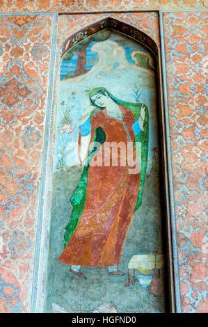 Painting of Persian woman in Safavid grand palace Ali Qapu located at Naqsh e Jahan Square in Isfahan in Iran - Stock Photo