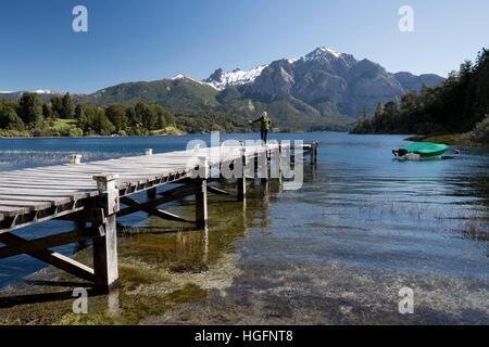 Wooden pier and snow-capped mountains on Lago Perito Moreno, Llao Llao, near Bariloche, Nahuel Huapi National Park, - Stock Photo