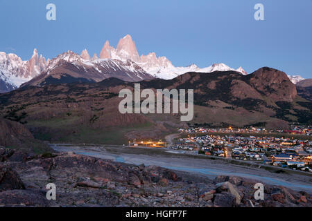 View over Mount Fitz Roy and Cerro Torre with town of El Chalten, El Chalten, Patagonia, Argentina, South America - Stock Photo