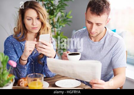 Couple enjoying breakfast in dining room - Stock Photo