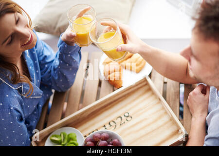 Young couple having healthy breakfast - Stock Photo