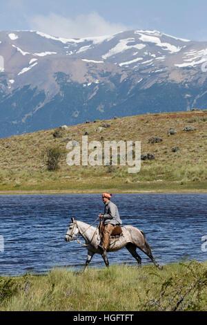 Gaucho on horse by lake at Estancia Alta Vista, El Calafate, Parque Nacional Los Glaciares, Patagonia, Argentina, South America